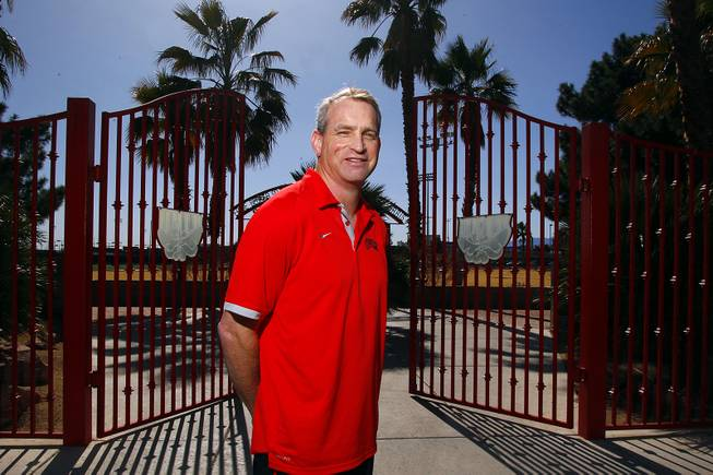 New UNLV football defensive coordinator Tim Hauck is seen outside the gates to Rebel Park on Wednesday, Feb. 27, 2013.