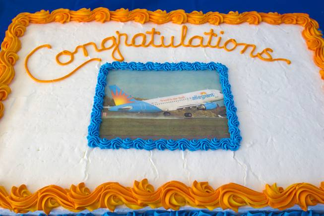 A cake decorated with a photo of a Allegiant Airbus A319 passenger jet is displayed as Allegiant Air employees get their first look at the new jet at McCarran International Airport Thursday, Feb. 28, 2013. The new jets are much more fuel efficient than the company's current jets.