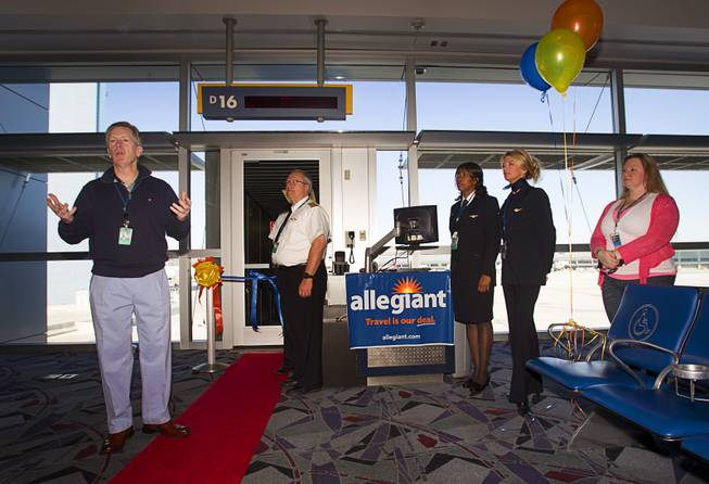 Maurice J. Gallagher Jr., left, chairman/CEO of Allegiant Air, speaks to employees waiting to get their first look at a new Airbus A319 passenger jet at McCarran International Airport Thursday, Feb. 28, 2013. The new jet is more fuel efficient than the company's current jets.