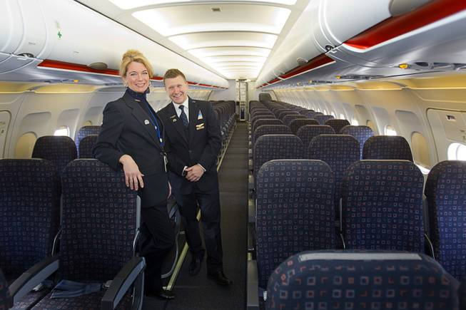 Theresa Mack, an inflight training instructor, and Allen Thieman, inflight manager for Las Vegas, pose in new Allegiant Air Airbus A319 passenger jet at McCarran International Airport Thursday, Feb. 28, 2013. The new jet is more fuel efficient than the company's current jets.