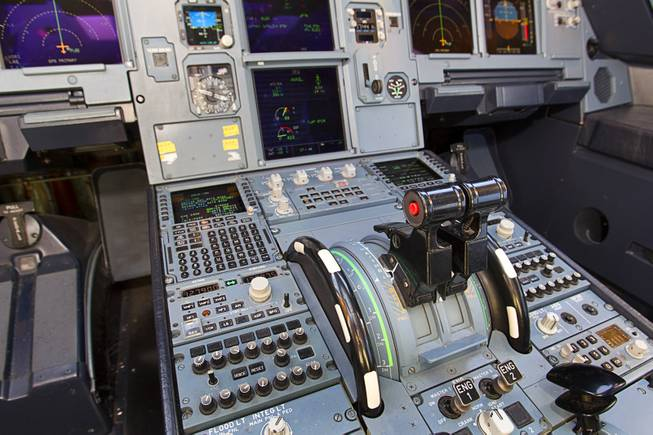 The cockpit is shown in a new Allegiant Air Airbus A319 passenger jet at McCarran International Airport Thursday, Feb. 28, 2013. The new jet is more fuel efficient than the company's current jets. Thruster levers are at center.