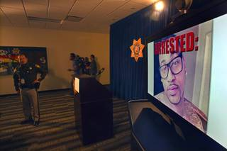 A photo of Ammar Harris is displayed on a video monitor before a news conference at Las Vegas Metropolitan Police headquarters Thursday, Feb. 28, 2013 after Harris was arrested in North Hollywood. Harris, 26, is the suspect of last Thursday's shooting and accident on the Las Vegas Strip that left three people dead.