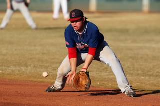 Coronado baseball player Chandler Blanchard scoops up a grounder during practice Feb. 28, 2013.