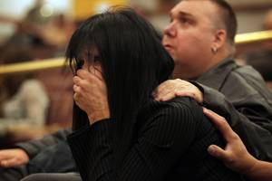 Rondha Gibson, the widow of Stanley Gibson, listens during the first Police Fatality Public Fact-finding Review concerning the Dec. 12, 2011 shooting of Stanley Gibson by a Metro Police officer at the Clark County Government Center in Las Vegas on Thursday, Feb. 28, 2013.