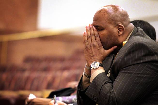 Rudy Gibson, the brother of Stanley Gibson, listens during the first Police Fatality Public Fact-finding Review concerning the Dec. 12, 2011 shooting of Stanley Gibson by a Metro Police officer at the Clark County Government Center in Las Vegas on Thursday, Feb. 28, 2013.