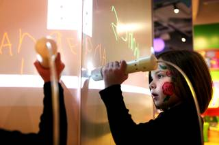 Angeline Schmitz, 5, makes digital drawings inside the Young At Art section of the museum during the donor ceremony and celebration at the new Discovery Children's Museum located in Symphony Park in Las Vegas on Friday, March 1, 2013.