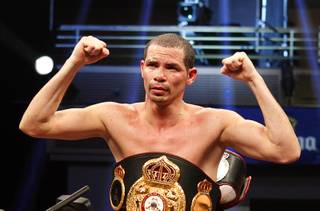 Richard Abril of Cuba celebrates after defending his WBA lightweight title against Sharif Bogere of Uganda at the Hard Rock Hotel in Las Vegas, Nevada March 2, 2013. Abril retained his title with an unanimous decision victory.