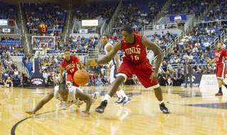 UNLV's Anthony Bennett and a UNR player go after the ball Saturday, March 2, 2013, during the Rebels' 80-63 victory at the Lawlor Events Center.