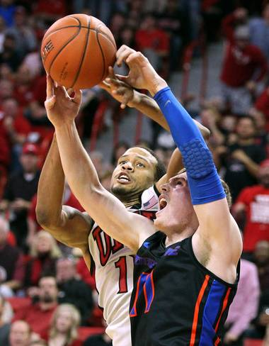 UNLV guard Bryce Dejean-Jones and Boise State guard Jeff Elorriaga fight for a rebound Tuesday, March 5, 2013 at the Thomas & Mack Center. UNLV won the game 68-64.