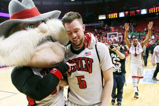 Hey Reb walks off with UNLV guard Katin Reinhardt after the Rebels knocked off Boise State 68-64 Tuesday, March 5, 2013 at the Thomas & Mack Center.