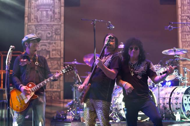 "Tracii Guns, John Payne and Pauly Shortino, playing his air guitar, rehearse for ""Raiding the Rock Vault"" in the LVH Theater at LVH on Wednesday, March 6, 2013."