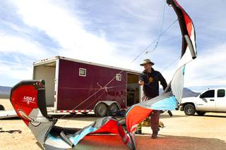 Brian Holgate, 28, prepares a kite for his specially-designed Peter Lynn kite buggy on the Ivanpah dry lake bed near Primm, Nev. Wednesday, March 6, 2013. Holgate set an unofficial kite buggy speed record of 84.4 mph at the lake bed in July 2012.