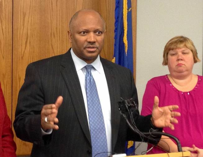 Clark County Schools Superintendent Dwight Jones answers questions today from media about his resignation, which he announced via email Tuesday, March 5, 2013. Jones reiterated that he was leaving to take care of his ailing mother. School board member Deanna Wright is at right.
