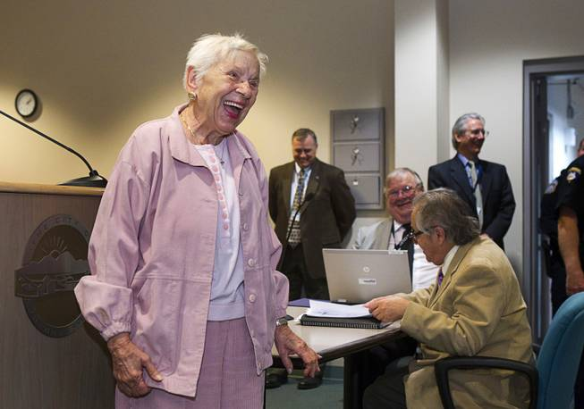World War II veteran Evie Hallas laughs as she and two other World War II veterans are honored during Veterans Court in Henderson Thursday, March 7, 2013. Hallas served in the Navy from 1943-1945.