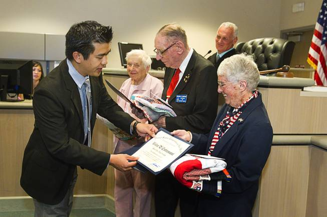Eric Guideng, representing Congressman Joe Heck, gives certificates of recognition to World War II veterans during Veterans Court in Henderson Thursday, March 7, 2013. From left are: Navy veteran Evie Hallas, Army veteran Richard Zimpfer and Coast Guard veteran Billie D'Entremont.