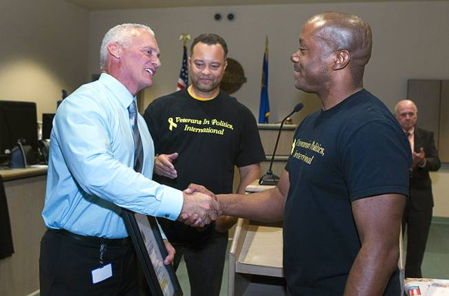 Judge Mark Stevens, left, shakes hands with Andre Haynes of Veterans in Politics International, after the group endorsed him during Veterans Court in Henderson Thursday, March 7, 2013. Veterans in Politics president Steve Sanson looks on at center.