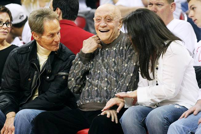 Former UNLV coach Jerry Tarkanian laughs while watching the UNLV vs. Fresno State game  Saturday, March 9, 2013 at the Thomas & Mack Center.