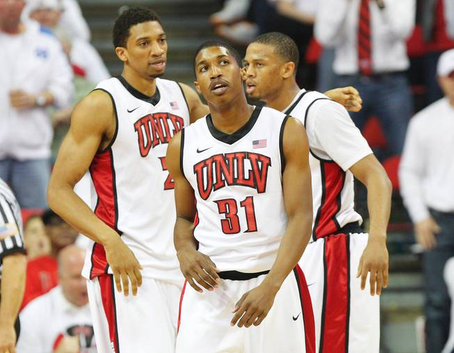UNLV players from left, Khem Birch, Justin Hawkins and Bryce Dejean-Jones gather themselves during a break in action against Fresno State Saturday, March 9, 2013 at the Thomas & Mack Center. Fresno State upset UNLV 61-52.