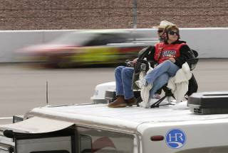 NASCAR fans watch from the tops of their recreational vehicles during practice for the NASCAR Sprint Cup Series race, Saturday, March 9, 2013, in Las Vegas. (AP Photo/Julie Jacobson)