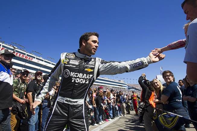 Driver Jimmie Johnson (48) greets a fan during driver introductions at the Kobalt Tools 400 NASCAR race at the Las Vegas Motor Speedway Sunday, March 10, 2013.