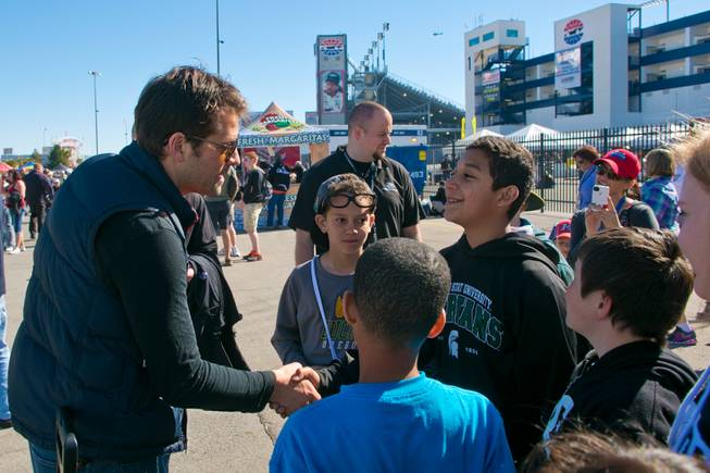Misha Collins, from The CW's Supernatural and founder of the non-profit Random Acts, talks with kids from the Boys and Girls Club of Las Vegas during Random Acts' AMOK event at the Las Vegas Motor Speedway, Sunday March 10, 2013.