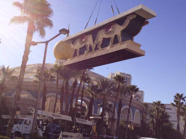 A piece the of the Sahara sign comes down during the dismantling of the casino sign, Tuesday, Mar. 12, 2013.