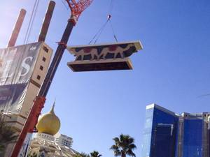 A crane lowers part of the Sahara sign during the dismantling of the casino sign, Tuesday, Mar. 12, 2013.