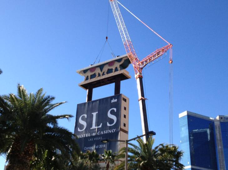 A crane lowers a portion of the Sahara sign Tuesday, March 12, 2013 as part of a project to