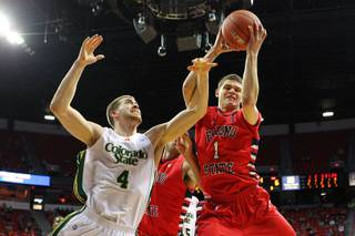 Fresno State guard Tyler Johnson grabs a rebound from Colorado State forward Pierce Hornung during their Mountain West Conference Tournament game Wednesday, March 13, 2013 at the Thomas & Mack.