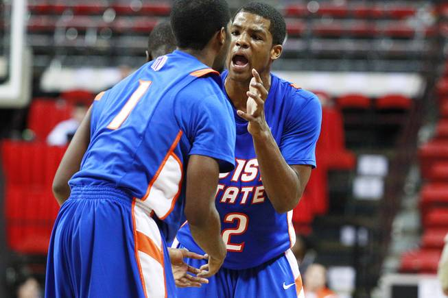 Boise State guard Derrick Marks, right, talks to teammate Mikey Thompson during their Mountain West Conference Tournament game against San Diego State Wednesday, March 13, 2013 at the Thomas & Mack Center. SDSU won the game 73-67 and will face New Mexico on Friday.