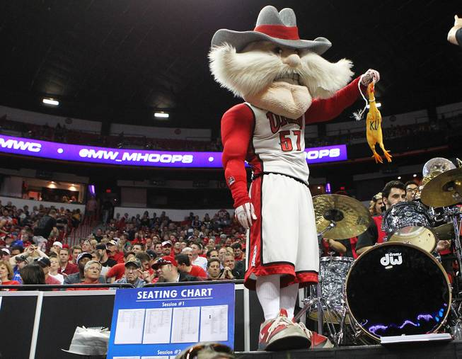 "UNLV mascot Hey Reb holds a rubber chicken with the initials ""KU"" during their game against Air Force at the Mountain West Conference Tournament on Wednesday, March 13, 2013, at the Thomas & Mack."