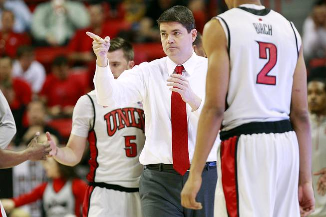 UNLV head coach Dave Rice points to one of his players during a timeout in their Mountain West Conference Tournament game against Air Force on Wednesday, March 13, 2013, at the Thomas & Mack. UNLV won 72-56.