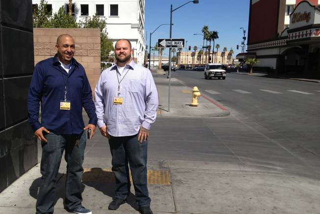Downtown Rangers Dave Lawson, left, and supervisor Jesse Hammond pose for a photo near the Beat coffee shop, Wednesday, Mar. 13, 2013.