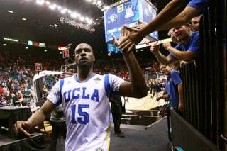 UCLA forward Shabazz Muhammad slaps hands with fans after the Bruins beat Arizona State 80-75 in their Pac-12 Basketball Tournament game Thursday, March 14, 2013 at the MGM Grand Garden Arena.