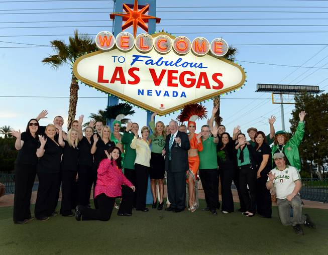 "Clark County Commissioner Chris Giunchigliani (in yellow), ""The Voice Ireland"" host Kathryn Thomas and former Mayor Oscar Goodman, the Las Vegas Convention and Visitors Authority Host Committee chairman, are flanked by staff from Ri Ra Irish Pub at Mandalay Bay and showgirls at the Welcome to Fabulous Las Vegas sign on Wednesday, March 13, 2013."