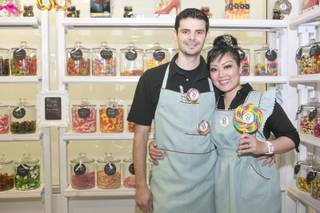 Victor and Arlene Bordinhao pose inside their candy shop, the B Sweet candy boutique at Tivoli Village, Thursday March 14, 2013.