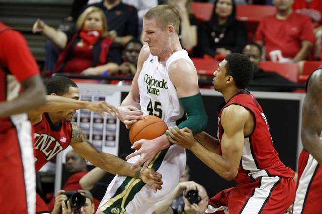 UNLV guard Anthony Marshall, left, and forward Khem Birch defend Colorado State forward Colton Iverson during their Mountain West Conference Tournament game Friday, March 15, 2013 at the Thomas & Mack Center.