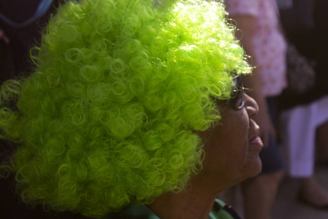 Francell Morgan wears her festive green wig during the St. Patrick's Day Parade in downtown Henderson, Saturday, Mar. 16, 2013.