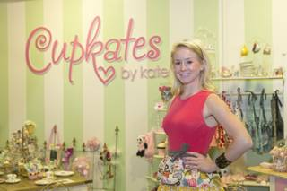 Kate Thompson, owner of Cupkates by Kate, stands inside her cupcake parlor at Tivoli Village, Friday, March 15, 2013.