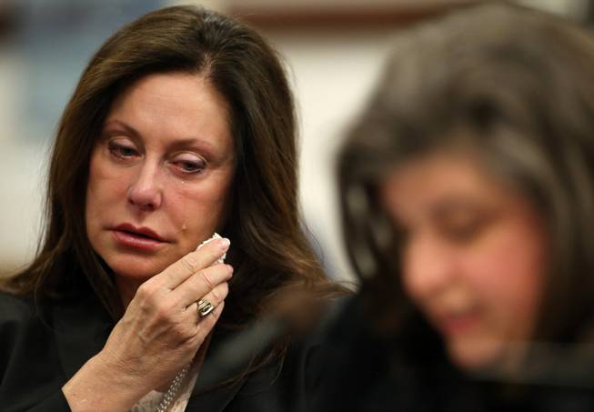 Bridgette Denison wipes away tears as her sister-in-law Lauren Denison testifies in a Senate Judiciary hearing at the Legislative Building in Carson City, Nev., on Thursday, March 14, 2013. The family is urging lawmakers to support a bill that would require anyone arrested for a felony to submit a DNA sample. The bill, commonly known as Brianna's Law, is named after Bridgette Denison's 19-year-old daughter who was murdered in Reno, Nev., in 2008.
