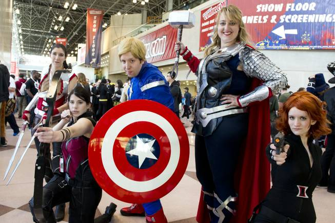 Costumed attendees pose on the floor of the New York Comic-Con fan convention in New York, Saturday, Oct. 13, 2012  in New York.
