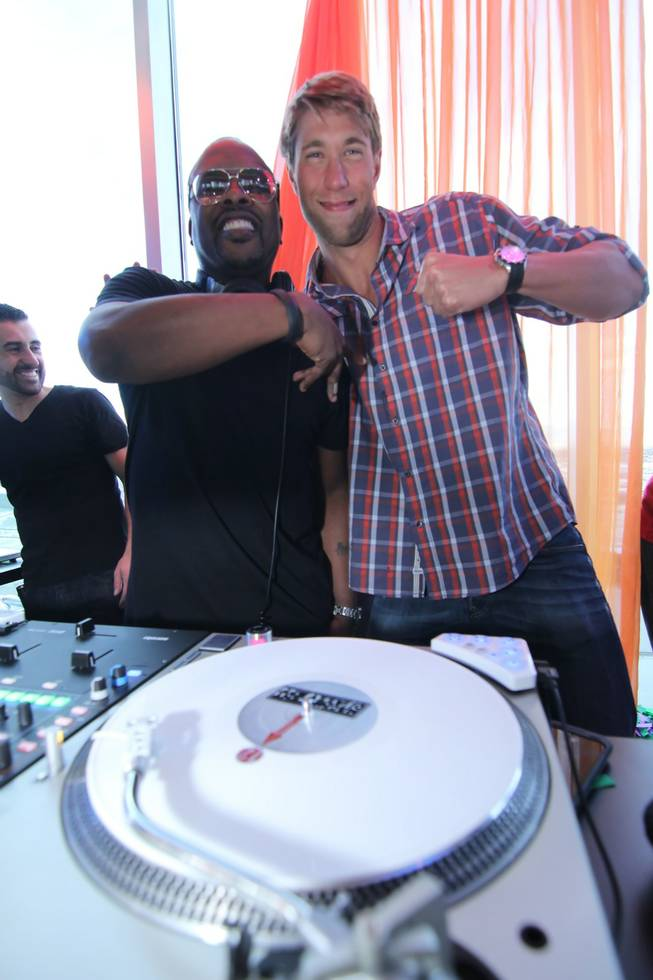 Matt Grevers, right, with DJ Jazzy Jeff, celebrates his bachelor party at GhostBar DayClub in the Palms on Saturday, March 9, 2013.