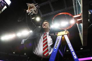 New Mexico head coach Steve Alford finishes cutting down the net after the Lobos defeated UNLV 63-56 to win the Mountain West Conference Tournament championship game Saturday, March 16, 2013 at the Thomas & Mack Center.