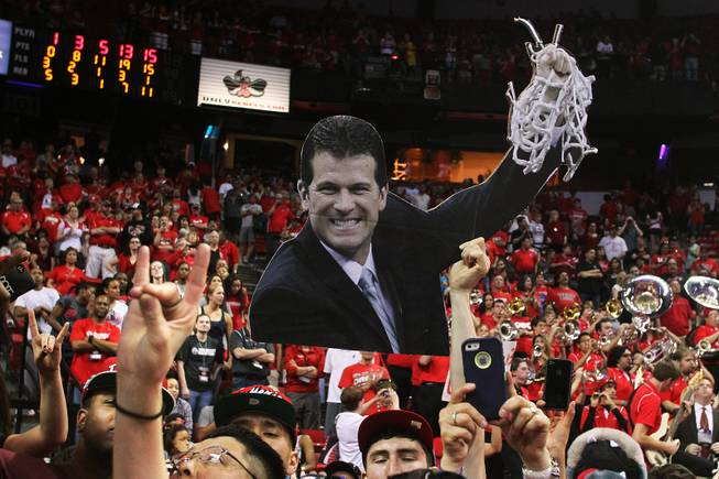 New Mexico fans hold up a cut out of coach Steve Alford after they defeated UNLV 63-56 in Mountain West Conference Tournament championship game Saturday, March 16, 2013 at the Thomas & Mack Center.
