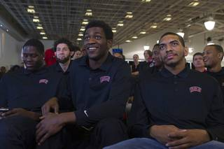 Members of the UNLV men's basketball team, from left, Anthony Bennett, Savron Goodman, and Anthony Marshall, learn their selection while watching the NCAA Tournament's Selection Show at the Mendenhall Center Sunday, March 17, 2013. UNLV will play Golden Bears in its NCAA tournament opener on Thursday at HP Pavilion in San Jose.