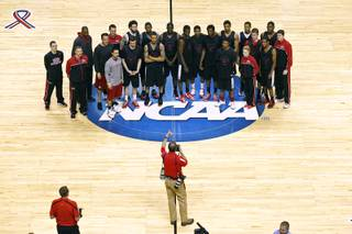 The UNLV basketball team has their photo taken by UNLV photographer R. Marsh Starks before practice for their second round NCAA Tournament game against Cal Wednesday, March 20, 2013 at the HP Pavilion in San Jose, Calif.