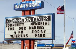 A sign telling residents about a memorial service is posted at the Convention Center in Hawthorne, Nev., near the Hawthorne Army Depot on Tuesday, March 19, 2013, where seven Marines were killed and several others seriously injured in a training accident Monday night, about 150 miles southeast of Reno in Nevada's high desert.