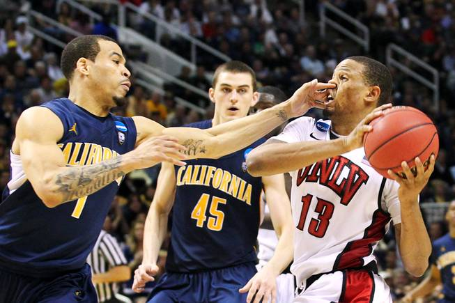UNLV guard Bryce Dejean-Jones gets a finger in his nose, and a flagrant foul, from Cal guard Justin Cobbs during their second round game at the NCAA Basketball Tournament Thursday, March 21, 2013 at the HP Pavilion in San Jose, Calif. UNLV lost to Cal 64-61 to exit the tournament after one game for the fourth year in a row.