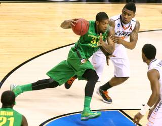 Oregon forward Carlos Emory drives against Oklahoma State forward Le'Bryan Nash during their second round game at the NCAA Basketball Tournament Thursday, March 21, 2013 at the HP Pavilion in San Jose, Calif.