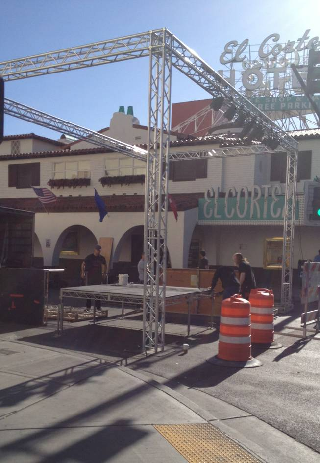 Workers erect a stage Thursday morning at Sixth and Fremont streets, for part of a weekend of events surrounding the Mint 400 off-road race. Streets downtown will be closed for parts of both Thursday and Friday to accommodate the events.